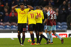 Watford's Marvin Zeegelaar (left) reacts after being shown a red card by referee Lee Probert during the Premier League match at Turf Moor, Burnley.