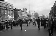 Sinn Fein (Provo) Dublin Parade.   K22..1976..25.04.1976..04.25.1976..25th April 1976..Sinn Fein held an Easter Rising Commemorative  parade..The parade started at St Stephens Green, Dublin and proceeded through the streets to the G.P.O.in O'Connell Street, the scene of the centre of the 1916 uprising..Pictured,the vanguard of the parade approaches the viewing rostrum at the G.P.O.(General Post Office)