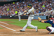 Oakland Athletics right fielder Josh Reddick bats against the Minnesota Twins on July 13, 2012 at Target Field in Minneapolis, Minnesota.  The Athletics defeated the Twins 6 to 3.  © 2012 Ben Krause