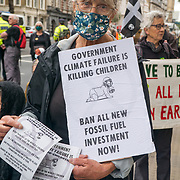 XR Pram Action Aug Rebellion protest in front of 10 Downing Street Slow funeral walk with white painted children's prams – because GOVERNMENT CLIMATE FAILURE IS KILLING CHILDREN. Our Government needs to 'STOP FOSSIL FUEL FUNDING' on 2021-08-31, London, UK.