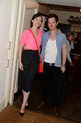SOPHIE ELLIS-BEXTOR and RICHARD JONES at a private screening of Cages of Shame in aid of Animals Asia UK held at The Electric Cinema, 191 Portobello Road, London W11 on 17th June 2013.