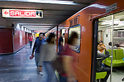 01 NOVEMBER 2004 - MEXICO CITY, MEXICO: Riders exit and board a train in the Cuauhtemoc station on the Mexico City Metro (subway) system. Because of high levels of air pollution, expensive gasoline, lack of parking and the comparatively high cost of cars most Mexicans rely on mass transit to get around the city of nearly 20 million people. PHOTO BY JACK KURTZ
