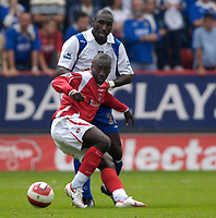 Photo: Daniel Hambury.<br />Charlton Athletic v Portsmouth. The Barclays Premiership. 16/09/2006.<br />Charlton's Jimmy Floyd Hasselbaink battles with Portsmouth's Sol Campbell, who is part of the defence which has yet to concede a goal.