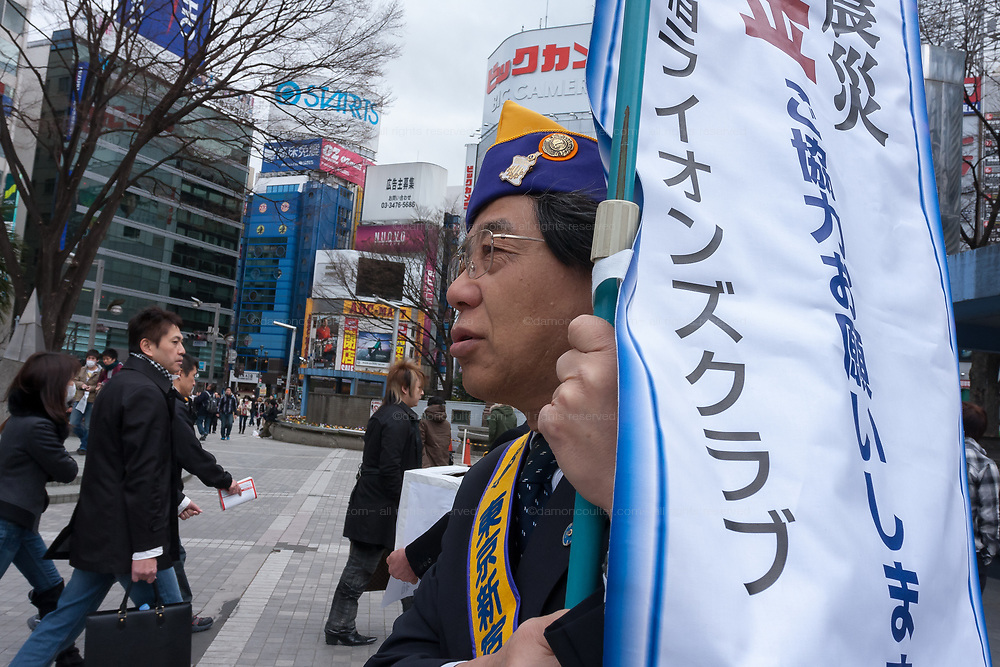Members of the Lions Club of Japan collecting donations  after a magnitude 9 earthquake and large tsunami hit the Tohoku region of north east Japan  on March 11th killing nearly 20,000 people and causing massive destruction along the whole coast, and a melt-down at the Fukushima Daichi nuclear power station. Shinjuku, Tokyo, Japan March 16th 2011