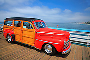 Red Classic Woody On The Pier
