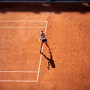 PARIS, FRANCE June 10. Barbora Krejcikova of the Czech Republic in action against Maria Sakkari of Greece as the early evening shadows creep across Court Philippe-Chatrier during the semi finals of the Women's singles competition at the 2021 French Open Tennis Tournament at Roland Garros on June 10th 2021 in Paris, France. (Photo by Tim Clayton/Corbis via Getty Images)