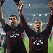 Trabzonspor's Ceyhun GULSELAM (L) and Umut BULUT (R) celebrate victory during their Turkish Superleague Derby match Besiktas between Trabzonspor at the Inonu Stadium at Dolmabahce in Istanbul Turkey on Sunday, 06 March 2011. Photo by TURKPIX