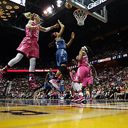 Maya Moore, Minnesota Lynx, drives to the basket challenged by Katie Douglas, (left), Connecticut Sun, during the Connecticut Sun Vs Minnesota Lynx, WNBA regular season game at Mohegan Sun Arena, Uncasville, Connecticut, USA. 27th July 2014. Photo Tim Clayton