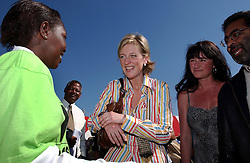 CAPE TOWN, SOUTH AFRICA - APRIL-29-2004 - Princess Astrid talks with a young girl infected with HIV / Aids during the celebration of the 1000th patient to receive ARV drugs in the Khayelitsha Township. There are about 500,000 people living in Khayelitsha and 10% of the population is infected with HIV / AIDS . (REPORTERS © JOCK FISTICK)....<br />