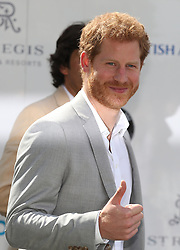Prince Harry arrives to take part in the Sentebale Royal Salute Polo Cup at the Singapore Polo Club.