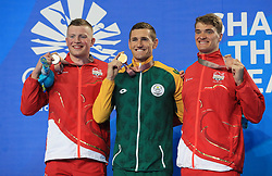 South Africa's Cameron Van Der Burgh with his Gold medal (centre), England's Adam Peaty with his Silver medal and England's James Wilby with his Bronze medal won in the Men's 50m Breaststroke at the Gold Coast Aquatic Centre during day five of the 2018 Commonwealth Games in the Gold Coast, Australia.