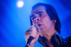Frontman Nick Cave, of Nick Cave and the Bad Seeds, under the spotlight, on stage tonight at The Barrowlands, Glasgow, Scotland.<br /> ©Michael Schofield.