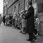 Mothers and children queue outside the Carnegie Trust Child Welfare Centre on Lord Edward Street, to get vaccinated against smallpox. .05.02.1962