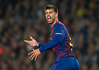 BARCELONA, SPAIN - APRIL 03: Gerard Pique of Barcelona reacts during the UEFA Champions League quarter-final second leg match between FC Barcelona and AC Milan at the Camp Nou stadium on April 3, 2012 in Barcelona, Spain.  (Photo by Manuel Queimadelos Alonso/Getty Images)