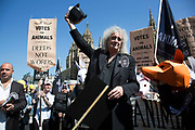 London, UK, 23rd April 2015. Brian May and campaigners at an animal welfare General Election drive. A day of action including a march on Parliament marks the launch of the 'Votes for Animals' campaign to highlight the importance of animal welfare issues in the General Election.  The aim of the campaign is to help inform the public on where their local candidates stand on the issue of animal welfare and to take this into consideration when voting. The initiative is spearheaded by ethical cosmetic company Lush, and backed by animal protection organisations League Against Cruel Sports, Animal Aid and Brian May's Common Decency organization.