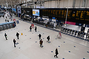 Interior of Waterloo Station which is normally full of commuters and travellers, is eerily quiet and silent with most people observing the stay at home message as the national coronavirus lockdown three continues on 28th January 2021 in London, United Kingdom. Following the surge in cases over the Winter including a new UK variant of Covid-19, this nationwide lockdown advises all citizens to follow the message to stay at home, protect the NHS and save lives.