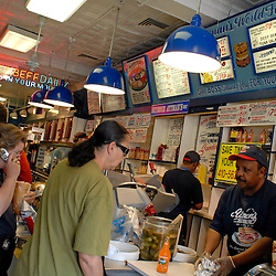 A long line waits for their deli orders at Attman's New York Delicatessen, a fixture on Baltimore's Corned-Beef Row since 1915...Photo by Susana Raab