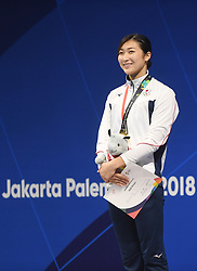 JAKARTA, Aug. 24, 2018  Gold medalist Ikee Rikako of Japan attends the awarding ceremony of women's 50m freestyle final of swimming at the 18th Asian Games in Jakarta, Indonesia, Aug. 24, 2018. (Credit Image: © Pan Yulong/Xinhua via ZUMA Wire)