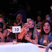 DAYTONA BEACH, FL - AUGUST 15: Spectators smile during the Alberto Ignacio Palmetta v Tre'Sean Wiggins boxing match at the Ocean Center on August 15, 2020 in Daytona Beach, Florida. (Photo by Alex Menendez/Getty Images) *** Local Caption ***
