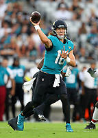 Jacksonville Jaguars quarterback Trevor Lawrence (16) looks to pass during the first half of an NFL preseason football game against the Cleveland Browns, Saturday, Aug. 14, 2021, in Jacksonville, Fl.<br /> <br /> (Tom DiPace via AP)