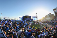 Brighton players arrive on stage with fans and supporters look on during the Brighton & Hove Albion Football Club Promotion Parade at Brighton Seafront, Brighton, United Kingdom on 14 May 2017. Photo by Phil Duncan.
