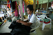 Women labor in a textile factory in Betio. Kiribati, with its relatively small land area, narrow based economy, and rapid urban growth shows significant signs of emergence of urban poverty as can be observed by the proliferation of squatters areas and an overall deterioration of the quality of life in Tarawa.