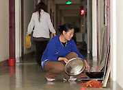 SHENYANG, CHINA - (CHINA OUT) <br /> <br /> Living In A Toilet<br /> Wang Zhixia cooks outside of the home, a male toilet in Shenyang, Liaoning Province of China. Zeng Lingjun comes from a poor family in Fumin Village of Jilin Province. In 1999, Zeng got the admission letter of Heilongjiang Institute of Science and Technology, but he didn't go to the school, as he had no money to pay tuition. And then, he came to Shenyang to make money. In 2006, he rent a 20 square meters male toilet not used before in a hotel, and made a simple reconstruction. In 2010, he married a cleaner Wang Zhixia, and they got a baby one year later. <br /> ©ChinaFoto/Exclusivepix
