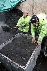 Men composting waste from vegetable market for Emerge Recycling; Manchester,