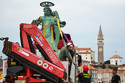 After two months of restoration, the Statue of Archangel Michael, made of copper plate, returned to Piran. The image shows a view of the statue of Archangel Michael on the truck and in background view St. George's Parish Church before helicopter placing it on top of the church's clock, on October 15, 2018 in Piran, Slovenia. Photo by Matic Klansek Velej / Sportida