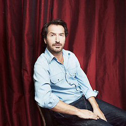 PARIS, FRANCE. SEPTEMBER 12, 2012. French comedian Edouard Baer at home in Paris. Photo: Antoine Doyen