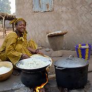 Dinner is prepared in Koumbadiouma with special ingredients: love and smiles. Kolda, Senegal.