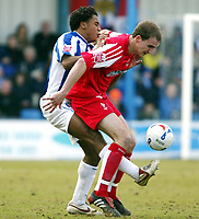 Photo: Chris Ratcliffe.<br />Colchester United v Swindon Town. Coca Cola League 1. 18/03/2006.<br />Neil Danns (L) of Colchester tussles with Andrew Nicholas of Swindon