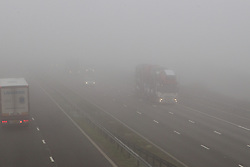 © London News Pictures. 14/03/2014. Thick fog covers the M5 motorway, Somerset. 14th March 2014. Photo credit: London News Pictures