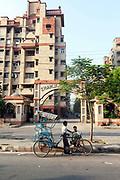 Rickshaw wallahs wait for customers outside a gated community in Dwarka, New Delhi, India