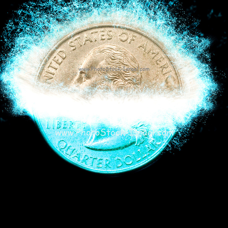 Digitally Enhanced US one Quarter Dollar coin (25 cents) splashes into water