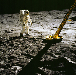 The Moon - (FILE) -- Apollo 11 astronaut Edwin Aldrin stands near the leg of the lunar module on the Moon. Despite the fact that the backpacks and astronauts only weighed 1/6 on their 350 pound Earth weight, their center of gravity was shifted so they had to lean slightly forward to balance. Footprints are clearly visible in the foreground. Photo by CNP/ABACAPRESS.COM