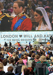 © under license to London News Pictures. LONDON, UK  28/04/2011. The Royal Wedding of HRH Prince William to Kate Middleton.  People watch the wedding on giant screens in Hyde Park, London. Photo credit should read Stephen Simpson/LNP. Please see special instructions.