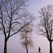 A lone runner on a misty morning in Seattle