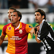 Galatasaray's Johan Elmander and Besikta's Escude (R) during their Turkish Superleague soccer derby match Besiktas between Galatasaray at the Inonu Stadium at Dolmabahce in Istanbul Turkey on Thursday, 26 August 2012. Photo by TURKPIX