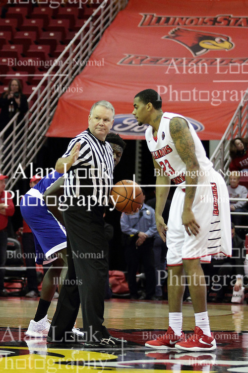 22 December 2015: Deontae Hawkins(23) and Demontez Loman(11) prepare to tip off as lined up by official Mike Stuart. Illinois State Redbirds host the Tennessee State Tigers at Redbird Arena in Normal Illinois (Photo by Alan Look)