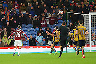 Steven Defour of Burnley (l) chips the ball to score his teams 2nd goal. The Emirates FA cup 4th round match, Burnley v Bristol City at Turf Moor in Burnley, Lancs on Saturday 28th January 2017.<br /> pic by Chris Stading, Andrew Orchard Sports Photography.