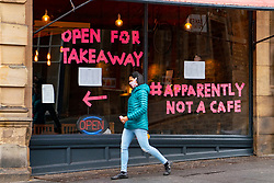 Edinburgh, Scotland, UK. 24 October 2020. Scran cafe restaurant on Cockburn Street has put message in window relating to the confusing regulations on local lockdown from Scottish Government on Covid-19. Iain Masterton/Alamy Live News