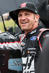 October 5, 2018 - Dover, DE, U.S. - DOVER, DE - OCTOBER 05: Clint Bowyer driver of the #14 Haas VF1/Rush Truck Centers Ford on the grid, waiting out a rain delay for qualifying for the Monster Energy NASCAR Cup Series Gander Outdoors 400 on October 05, 2018, at Dover International Speedway in Dover, DE. Qualifying was canceled after approximately a 40 minute delay. (Photo by David Hahn/Icon Sportswire) (Credit Image: © David Hahn/Icon SMI via ZUMA Press)