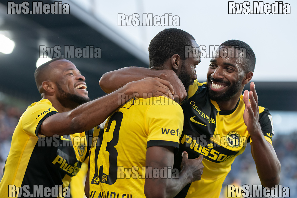 LAUSANNE, SWITZERLAND - SEPTEMBER 22: Nicolas Moumi Ngamaleu #13 of BSC Young Boys celebrates his goal with Ulisses Garcia #21 and Meschack Elia #15 of BSC Young Boys during the Swiss Super League match between FC Lausanne-Sport and BSC Young Boys at Stade de la Tuiliere on September 22, 2021 in Lausanne, Switzerland. (Photo by Basile Barbey/RvS.Media)
