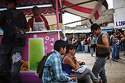 Students gather with friends at the streets in the evening in Ciudad Nezahualcoyotl, March 29, 2011.