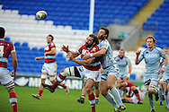 Sebastien Chabal of Racing Metro jumps for a high ball with Cardiff's Chris Czekaj. Heineken cup, Cardiff Blues v Racing Metro at the Cardiff city stadium in Cardiff, South Wales  on Sunday 22nd  Jan 2012. pic by Andrew Orchard, Andrew Orchard sports photography,