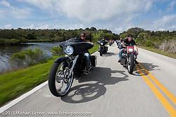 "Crystal Oxendine rides her 30"" front wheel custom Harley-Davidson Street Glide through Tamoka State Park beside Jennifer and Zach Johnson during Daytona Beach Bike Week  2015. FL, USA. Friday, March 13, 2015.  Photography ©2015 Michael Lichter."