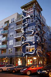 United States, Washington, Seattle. Modern apartment building with ground-floor retail shops in the Fremont neighborhood.