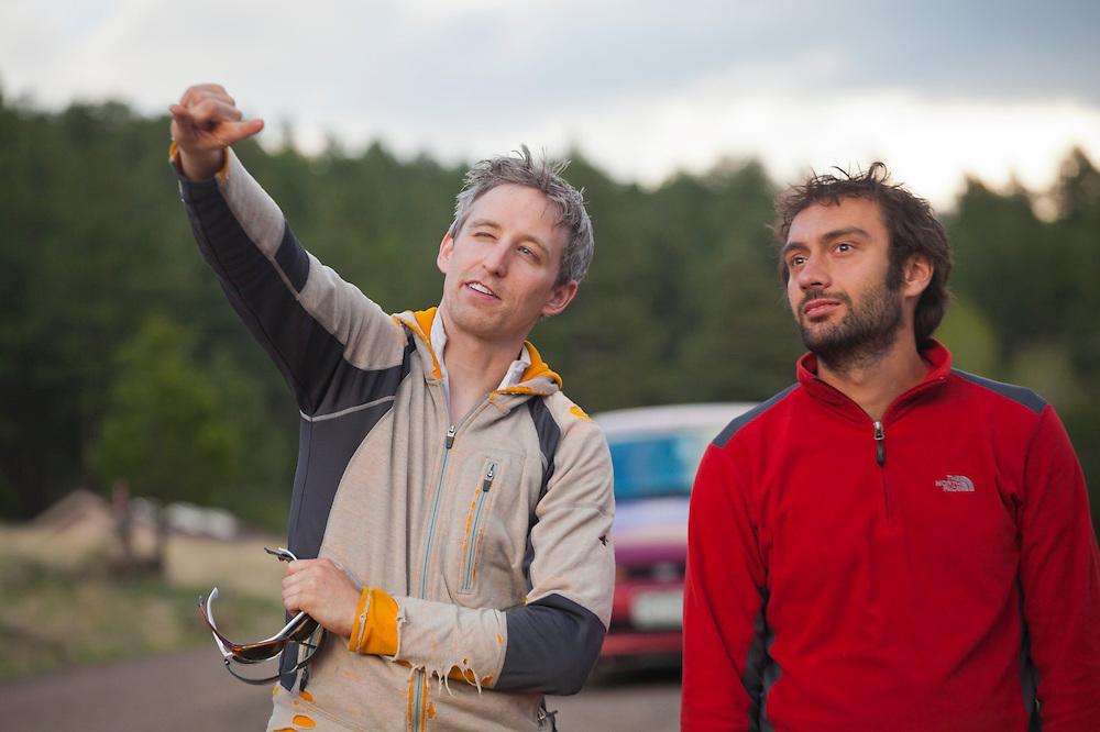David Coffey (l-r) and Marco Binotti watch the solar eclipse on May 20, 2012 near Pine, Colorado.