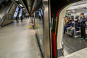 March 14, 2020, London, England, United Kingdom: People wearing face masks taking Jubilee Line underground train at Canary Wharf in London, Saturday, March 14, 2020. For most people, the new COVID-19 coronavirus causes only mild or moderate symptoms, such as fever and cough. For some, especially older adults and people with existing health problems, it can cause more severe illness, including pneumonia. (Credit Image: © Vedat Xhymshiti/ZUMA Wire)